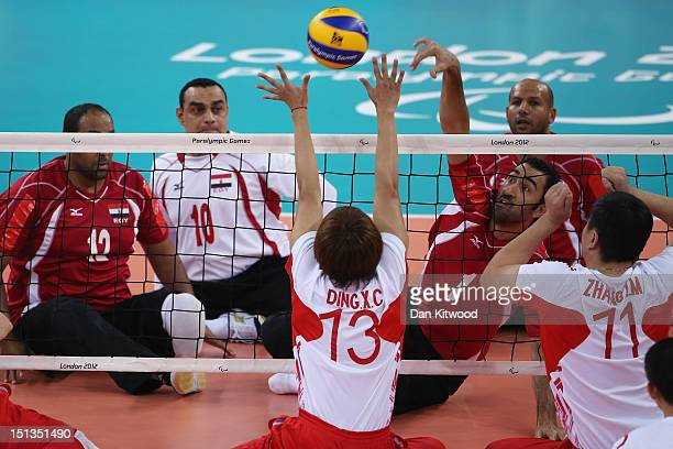 China's Xiaochao Ding attempts to block a shot by Hesham Abdelmaksod of Egypt during the men's Sitting Volleyball 58 Clasification match on day 8 of...