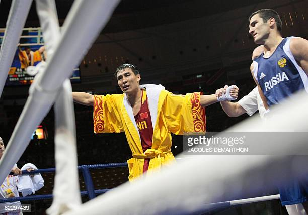 China's Xiaoping Zhang is declared winner after defeating Russia's Artur Beterbiev during their 2008 Olympic Games Light Heavyweight boxing bout on...