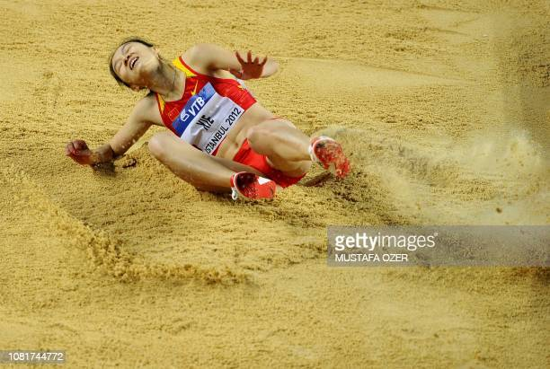 China's Xie Limei lands on the sand during the women's triple jump qualifications at the 2012 IAAF World Indoor Athletics Championships at the Atakoy...