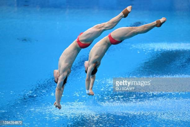 China's Xie Siyi and China's Wang Zongyuan compete in the men's synchronised 3m springboard diving final event during the Tokyo 2020 Olympic Games at...