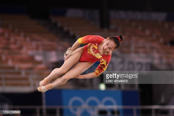 China's Xijing Tang competes in the floor event of the artistic gymnastics women's team final during the Tokyo 2020 Olympic Games at the Ariake...