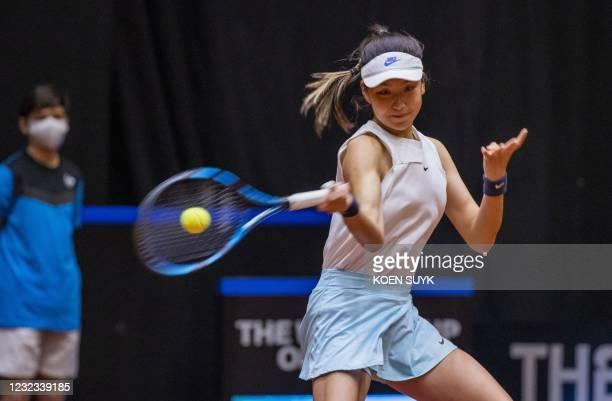 China's Xinyu Wang returns the ball to Dutch tennisplayer Kiki Bertens during the Billy Jean King Cup tennis Play-off in Den Bosch on April 16, 2021....