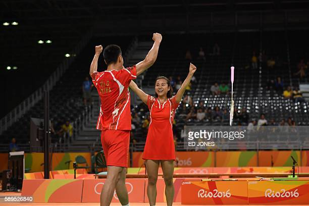 China's Xu Chen and China's Ma Jin celebrate winning against South Korea's Kim Ha Na and South Korea's Ko Sung Hyun during their mixed doubles...