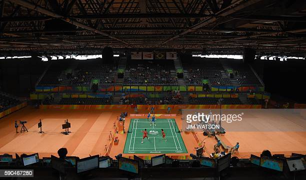 China's Xu Chen and China's Ma Jin return to China's Zhang Nan and China's Zhao Yunlei during the mixed doubles Bronze Medal badminton match at the...