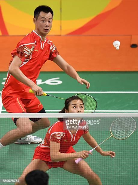 China's Xu Chen and China's Ma Jin return to Malaysia's Peng Soon Chan and Malaysia's Liu Ying Goh during their mixed doubles semifinal badminton...