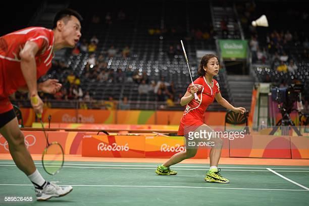 China's Xu Chen and China's Ma Jin return to South Korea's Kim Ha Na and South Korea's Ko Sung Hyun during their mixed doubles quarterfinal badminton...