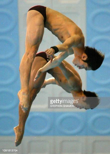 China's Xu Hao and Hu Jia perform in the men's 10m Synchronized Diving event 08 October 2002 at the 14th Asian Games in Busan China took the gold...