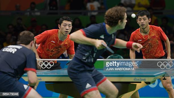 China's Xu Xin and China's Zhang Jike play against Britain's Paul Drinkhall and Britain's Samuel Walker in their men's team quarter-final table...
