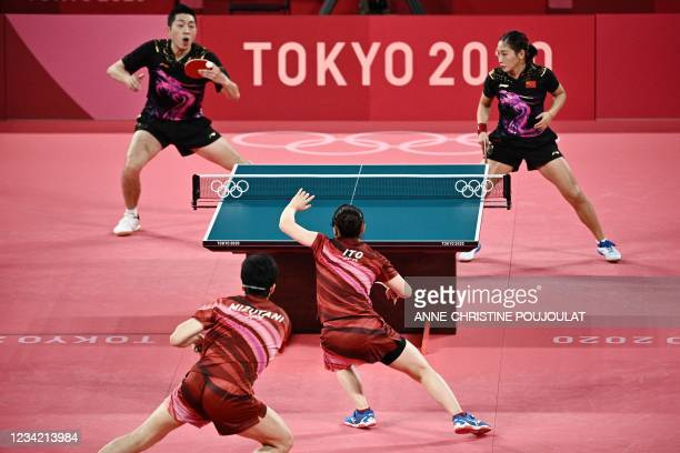 China's Xu Xin and Liu Shiwen compete against Japan's Jun Mizutani and Mima Ito in their mixed doubles table tennis final match at the Tokyo...
