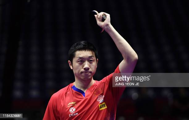 China's Xu Xin celebrates his victory against compatriot Ma Long during the men's singles final match at 2019 ITTF World Tour Korea Open table tennis...