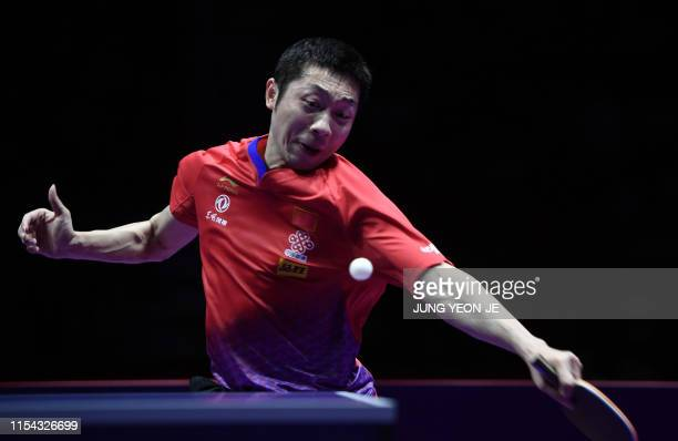 China's Xu Xin returns the ball against compatriot Ma Long during the men's singles final match at 2019 ITTF World Tour Korea Open table tennis...