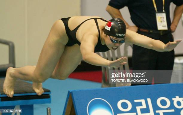 China's Xu Yanwei dives from the block at the start of the women's 50m freestyle heat at the 14th Asian Games in Busan 04 October 2002 Xu set the...