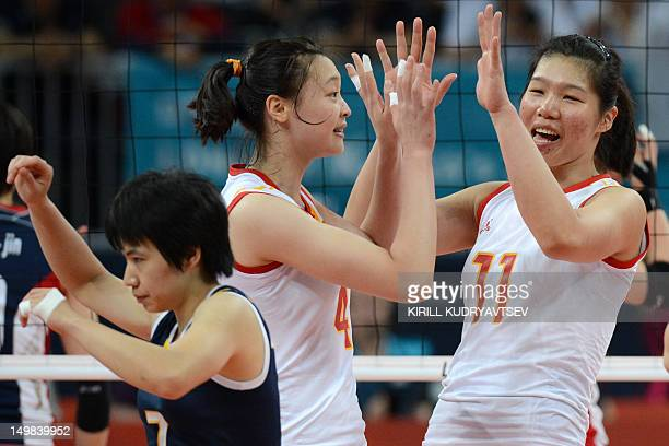 China's Xu Yunli Ruoqi Hui and Zhang Xian celebrate winning a point during the Women's preliminary pool B volleyball match between China and South...