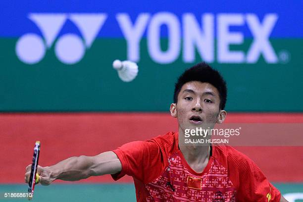 China's Xue Song plays a shot during his men's singles semifinal match against Japan's Kento Momota at the YonexSunrise India Open 2016 badminton...