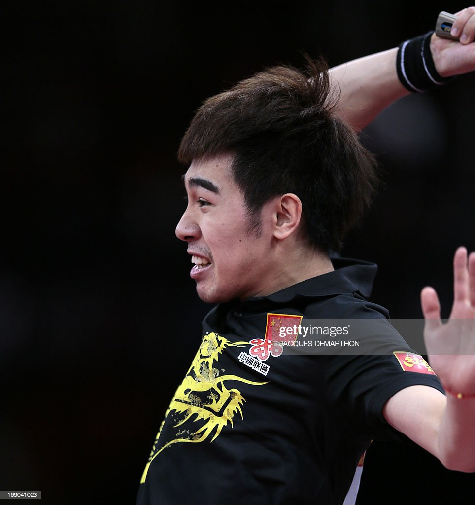 China's Yan An returns a ball to China's Wang Hao on May 19, 2013 in Paris during their Men's quarter-final match of the World Table Tennis Championships.