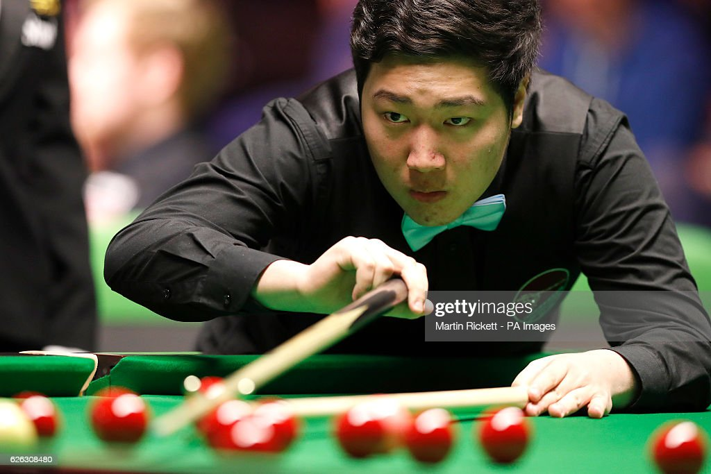 China's Yan Bingtao in action against Zhou Yuelong, during day six of the Betway UK Championships 2016, at the York Barbican.