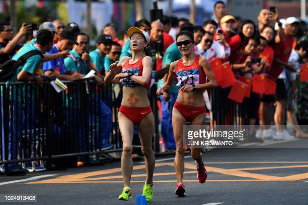 China's Yang Jiayu and China's Qieyang Shijie cross the finish line in the women's 20km walk race competition during the 2018 Asian Games in Jakarta...