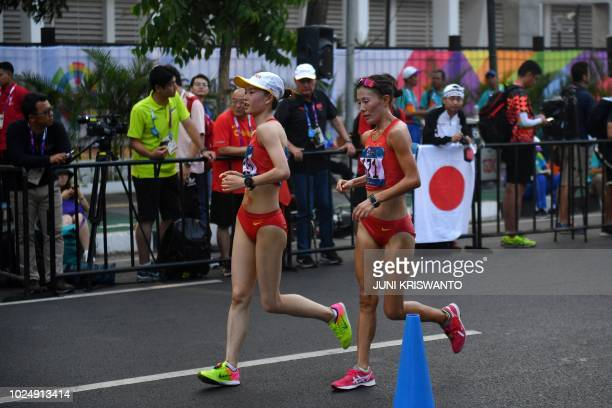China's Yang Jiayu and Qieyang Shijie compete in the women's 20km walk race competition during the 2018 Asian Games in Jakarta on August 29 2018