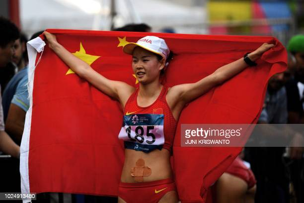 China's Yang Jiayu celebrates after winning the women's 20km walk race competition during the 2018 Asian Games in Jakarta on August 29 2018