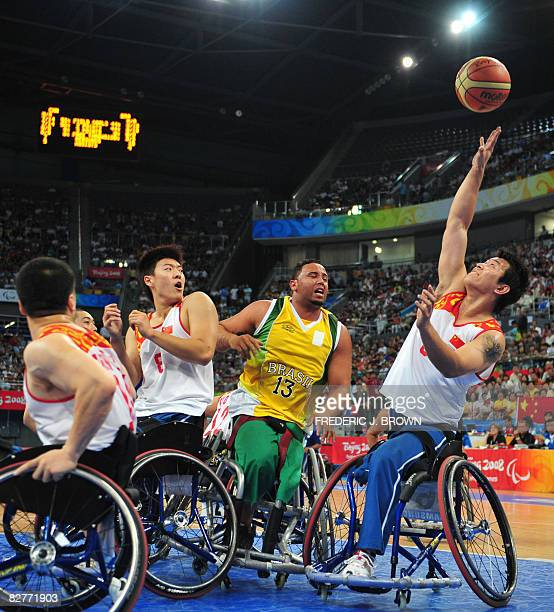 China's Yang Lei rebounds with Brazil's Leandro Mirando in their men's wheelchair basketball game at the 2008 Beijing Paralympic Games on September...