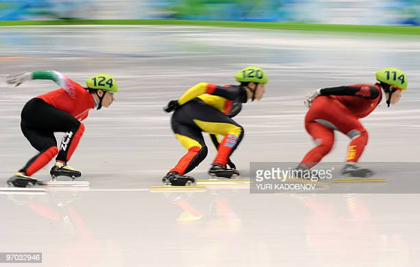 China's Yang Zhou Germany's Aika Klein and Hungary's Erika Huszar compete in the Women's Short Track Speedskating 1000m heats at the Pacific Coliseum...