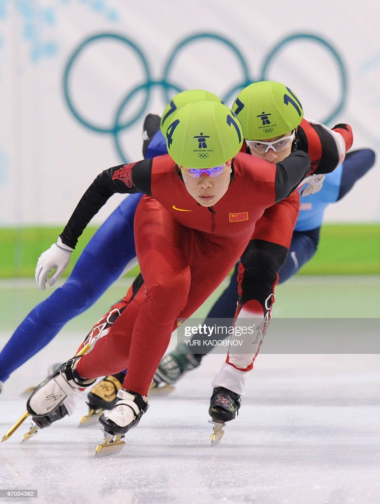 China's Yang Zhou leads the pack followed by Canada's Kalyna Roberge in the Women's Short Track Speedskating 3000m Relay final, at the Pacific Coliseum in Vancouver, during the XXI Winter Olympics on February 24 , 2010. AFP PHOTO / Yuri KADOBNOV
