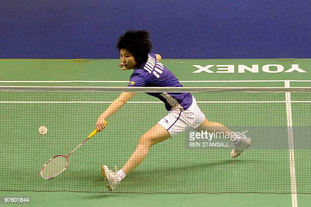 China's Yanjiao Jiang returns a shot to Malaysia's Mew Choo Wong during their woman's singles first round match at the Badminton All England Open...
