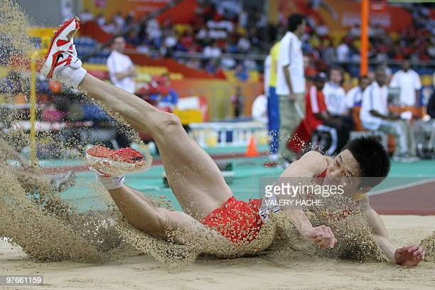 China's Yanxi Li competes in the men's triple jump qualifying round at the 2010 IAAF World Indoor Athletics Championships at the Aspire Dome in the...