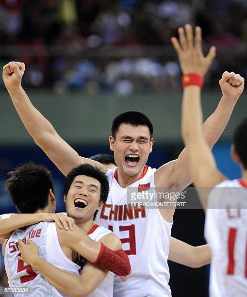 China's Yao Ming jubilates with teammates after beating Germany during their men's preliminary round group A basketball match of the Beijing 2008...