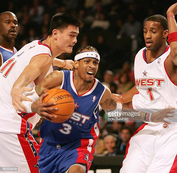 China's Yao Ming of the Western Conference team defends against Allen Iverson of the Eastern Conference as the West's Tracy McGrady and the East's...