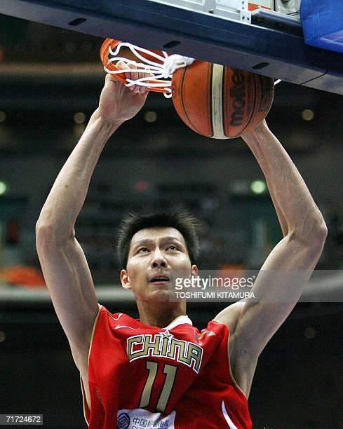 China's Yi Jianlian dunks during the eight-finals match between China and Greece at the World Basketball Championship, in Saitama, suburban Tokyo, 27...