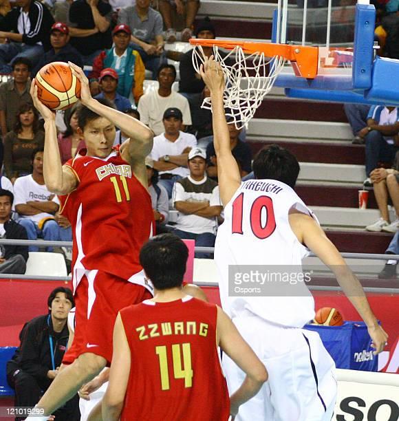 China's Yi Jianlian in action during the 15th Asian Games Doha 2006 Men's Basketball Preliminary Group F game between China and Japan at the...