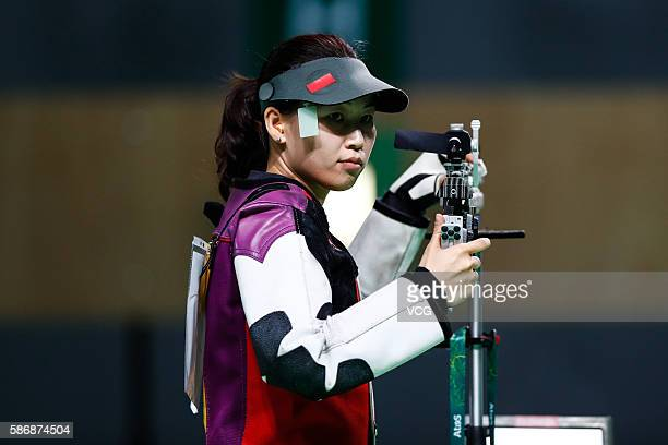 China's Yi Siling competes in the women's 10m air rifle shooting final during the Rio 2016 Olympic Games at the Olympic Shooting Centre on August 6...
