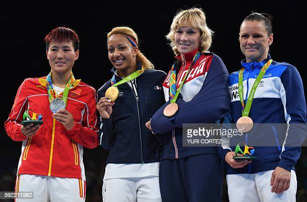 China's Yin Junhua France's Estelle Mossely Russia's Anastasiia Beliakova and Finland's Mira Potkonen pose on the podium with their medals following...