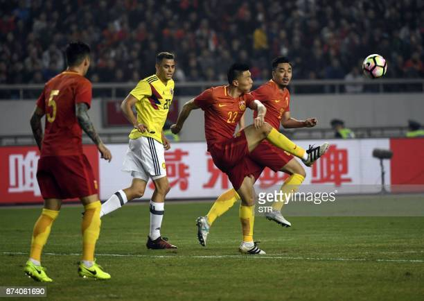 China's Yu Dabao kicks the ball during their international friendly football match against Colombia in Chongqing southwest China on November 14 2017...