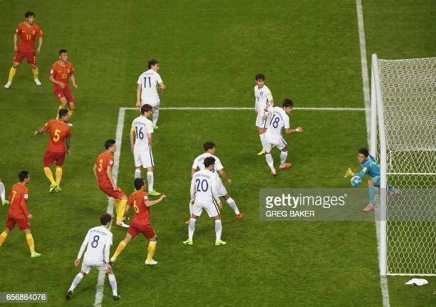 China's Yu Dabao shoots to score the only goal during their World Cup football qualifying match against South Korea, in Changsha, in China's central...