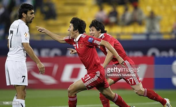 China's Yu Hai celebrates after he scored his team's first goal against Uzbekistan during their 2011 Asian Cup group A football match at the...