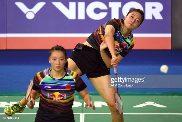 China's Yu Xiaohan plays a shot as her partner Huang Yaqiong looks on against Japan's Misaki Matsutomo and Ayaka Takahashi during their women's...