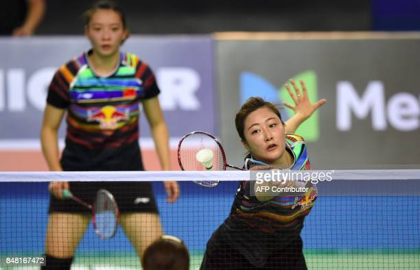 China's Yu Xiaohan plays a shot beside her partner Huang Yaqiong against South Korea's Chang YeNa and Lee SoHee during their women's doubles final...