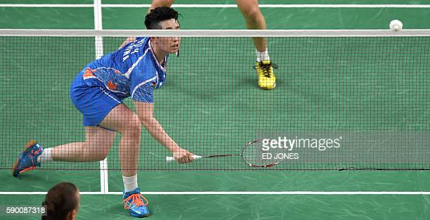 China's Yu Yang and China's Tang Yuanting return against Denmark's Christinna Pedersen and Denmark's Kamilla Rytter Juhl during their women's doubles...