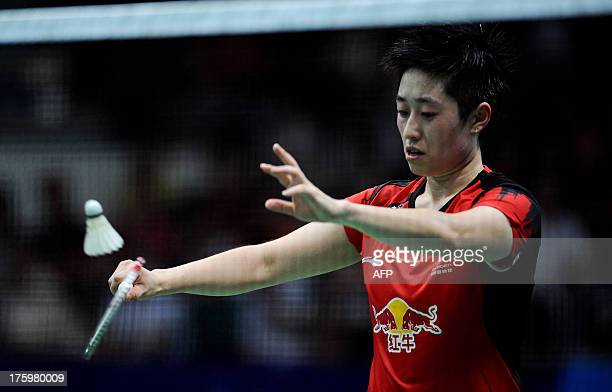 China's Yu Yang and Wang Xiaoli serve to South Korea's Eom Hye Won and Jang Ye Na during their women's doubles final at World Badminton Championships...