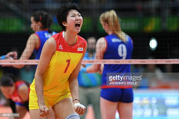 China's Yuan Xinyue celebrates after scoring during the women's Gold Medal volleyball match between China and Serbia at Maracanazinho Stadium in Rio...