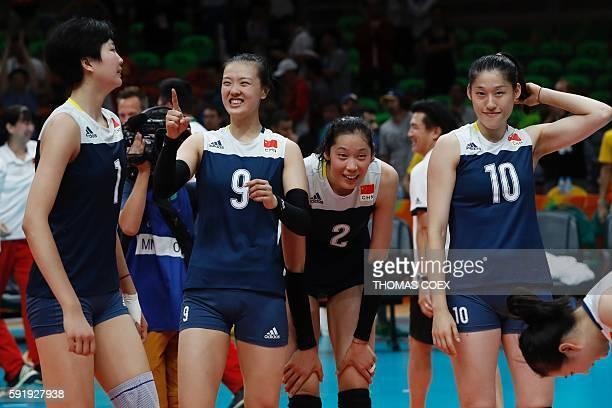 China's Yuan Xinyue China's Zhang Changning China's Zhu Ting and China's Liu Xiaotong react after winning their women's semifinal volleyball match...