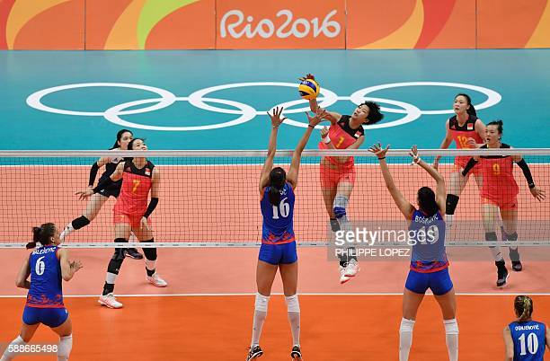 China's Yuan Xinyue spikes the ball during the women's qualifying volleyball match between China and Serbia at Maracanazinho Stadium in Rio de...