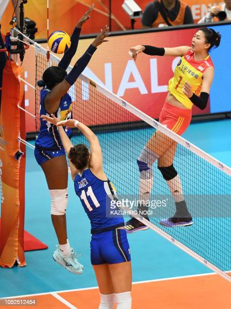 China's Yuan Xinyue spikes the ball over Italy's Miryam Fatime Sylla and Anna Danesi during the 2018 FIVB World Championship volleyball women's...