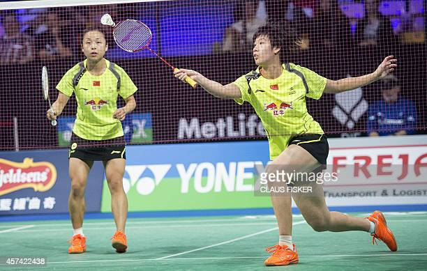 Chinas Yuanting Tang and Jin Ma return against Xiaoli Wang and Yang Yu China during the women's double semifinal match of the Denmark Open 2014...