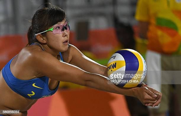 China's Yue Yuan digs the ball during the women's beach volleyball qualifying match between Switzerland and China at the Beach Volley Arena in Rio de...