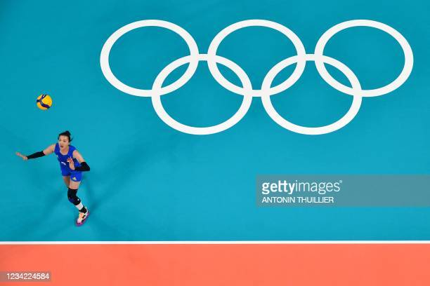 China's Zhang Changning serves in the women's preliminary round pool B volleyball match between China and USA during the Tokyo 2020 Olympic Games at...