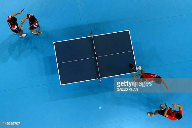 China's Zhang Jike and China's Wang Hao celebrate scoring to win gold against South Korea's Oh Sangeun and South Korea's Ryu Seungmin during the...
