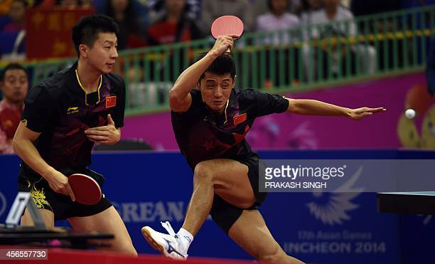 China's Zhang Jike and Ma Long compete against Japan's Koki Niwa and Kenta Matsudaria in the table tennis men's doubles semifinals match 2 during the...